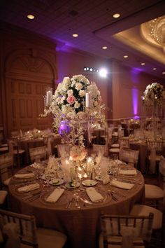 Hello ballroom! This stunner by yazy jo is the epitome of classic chic and represents a ballroom reception done oh-so right! Lush flowers, shimmery metallic and crystal touches and perfect lighting that transforms the space into an elegant wonderland. Everything about this celebration