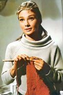 Audrey Hepburn -  in 'Breakfast at Tiffany's' scene when Holly Golightly shows off her sweater she is knitting...only to realize the sleeves are  too long and the pattern is gone! ...LOL... I LOVE this movie!