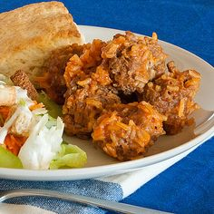 Mom's Rice Meatballs Recipe Main Dishes with ground beef, long-grain rice, evaporated milk, finely chopped onion, salt, pepper, condensed tomato soup, water