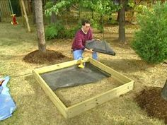 Use a staple gun to attach landscaping mesh to the inside of the frame to prevent grass and weeds from growing up through the sand.