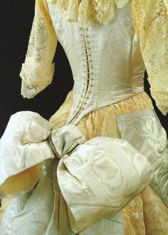 Fashion in details: Evening gown in silk satin, overlayed with machine made lace, England, 1885
