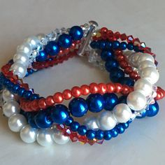 Red, white and blue glass pearls mixed with ruby red and clear shine bicone crystals. Finished with bar clasp, six strands total. Made 8 length unless otherwise specified.