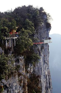 4,690 ft in the air, a glass walkway hugs the top of Zhangjiajie Tianmen Mountain (National Forest Park), China.
