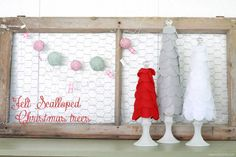felt scalloped christmas trees.  What I really love is the chicken wire window behind the trees for cards.