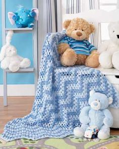 A simple granny idea gets turned on its side to create this wavy blanket. Shown in Bernat Baby Coordinates.
