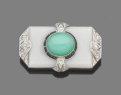 An art deco gem-set brooch, circa 1925  The rectangular chalcedony plaque set to the centre with an oval cabochon chrysoprase, within a calibré-cut onyx surround, highlighted with rose-cut diamonds, width 3.6cm.