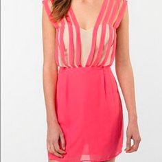 Urban Outfitters Pink and Ivory Dress Never been worn!!! Stunning coral pink and ivory minidress by Double in Brass from Urban Outfitters.  Beautiful, light weight chiffon with pale yellow enclosure on back. It is a size medium, but runs small in my opinion.  32 inch length from shoulder to hem.  If interested consider a bundle with other items for a discount!!  ✅offers ✅bundles trades Urban Outfitters Dresses