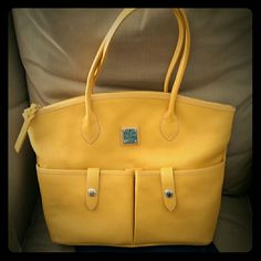 Dooney & Bourke Leather Handbag Golden Sunflower Yellow pebble leather bag. Gently loved - small signs of wear on bottom edge. Otherwise pristine. Warranty card and sleeper bag included. Dooney & Bourke Bags Satchels