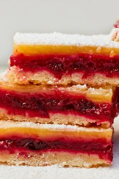 NYT Cooking: Cranberries that are quick-cooked into jam add a striking magenta color and complex tartness to these two-toned lemon bars. A thin layer of the classic lemon filling coats the cranberry mix like icing, and lemon zest boiled with the berries echoes the citrus taste of the lemony top. (Its pectin also thickens the jam.) To achieve a sturdy crust that isn't tough, melted butter is stirred into a f...