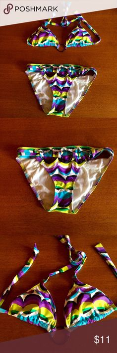 RAMPAGE Bikini M Purple, Black, Yellow SUMMER ISN'T OVER YET! This bikini has a 1960s vibe. It is a groovy purple/black/yellow/blue pattern, with decorative black rings. The bottom fits like a true medium. The top fits more like a S/M. The top has removable pads. I bought this in 2014 & wore it just one summer - its been in my dresser drawer ever since. In excellent condition - no stains or fading. I don't trade, sell on other sites, or discuss prices in comments. HAPPY POSHING! Victoria's…