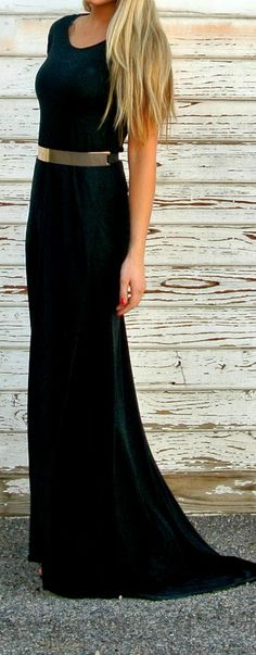 Modest black formal dress with gold belt.