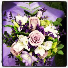 Lilac bridal bouquet in a holder