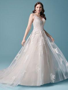 Winslow| Floral tulle a-line wedding dress with sequined lace motifs. #wedding #weddingdress #weddingdresses #bride #bridal #bridalgown #weddingplanning #weddingfashion #maggiesottero