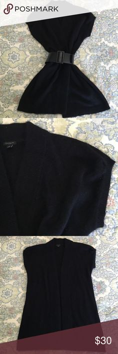 Ann Taylor Angora 53% angora rabbit hair and 47% nylon. So soft. Looks great belted or left open. No damage. Just so great! Ann Taylor Sweaters Cardigans