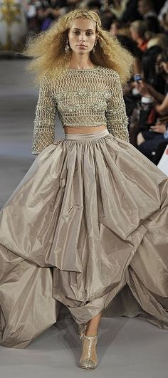 Oscar de la Renta... love this little peek... so tired of it all hanging out, glad to see waistlines coming back...