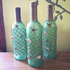 SHOP CLOSING! FINAL SALE!  These hand painted recycled wine bottles are hand wrapped within fish netting and accented with small starfish