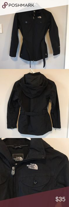 North face black coat. Good used condition. The North Face black rain jacket. Features hood that can be removed, lots of pockets and tie around the waist.  Size XS. The North Face Jackets & Coats