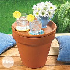 Placing a saucer on top of a large flowerpot can double as a pretty patio table and a storage container!