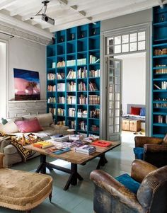 Storage is infinite in a cool set of curated built-in bookcases. Whether you're storing books or souvenirs from travels, built-ins are an easy way to add storage and style.