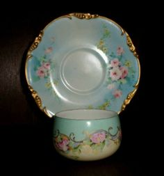 Limoges hand painted Cup and Saucer in pastel blue with pink flowers