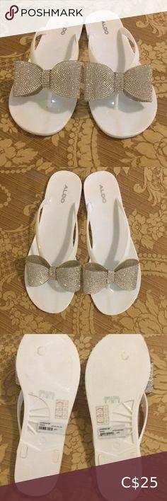 Aldo white size 8 sparkle bow flip flop sandals Gorgeous bow sparkle sandals brand new condition! Aldo Shoes Sandals Coral Sandals, Aldo Sandals, Rose Gold Sandals, Dressy Sandals, Bow Sandals, Aldo Shoes, Ankle Strap Sandals, Flip Flop Sandals, Black Sandals