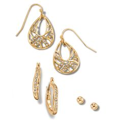 Goldtone 3 pair earring set with a glamorous combination of goldtone and rhinestones in an open teardrop style, a round ball stud, and rhinestone embellished hoops. Item # 614480