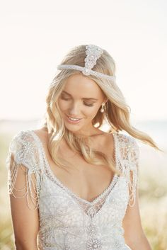 Anna Campbell Signature Collection   Grace Dress   Vintage-inspired bohemian boho barefoot bride wedding dresses   Hand embellished bridal gowns with sparkling hand beading   Low back detail with lace   Beaded shoulder detail   Vintage glamour   Bridal headpiece   1920s headpiece   Romantic wedding dress   Feature back detail with bow   Bridal earrings   #vintagebride #vintagewedding #glamourousweddingdress #beadedweddingdress #embellishedbridaldress #beachwedding