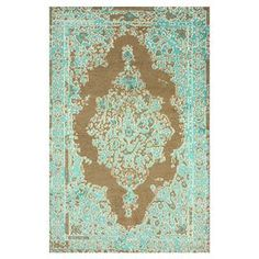 Wool and art silk rug with a damask motif. Hand-knotted in India.  Product: RugConstruction Material: Wool and art silkColor: TurquoiseFeatures:  Made in IndiaHand-knotted  Note: Please be aware that actual colors may vary from those shown on your screen. Accent rugs may also not show the entire pattern that the corresponding area rugs have.Cleaning and Care: These rugs can be spot treated with a mild detergent and water. Professional cleaning is recommended if necessary.