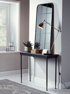 Made from metal with a distressed, vintage-effect finish, our mottled black console table is perfect for displaying ornaments and keepsakes in your hallway or living space. To complement the look, also see our matching Antiqued Metal Side Table affiliate
