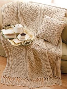 Irish Knit-Style Afghan & Pillow Crochet Pattern Download from e-PatternsCentral.com -- A variety of Aran-style cablework patterns give this cozy set gorgeous texture and style.