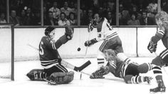MONTREAL, QC - 1970'S: Yvan Cournoyer #12 of the Montreal Canadiens shoots as goalie Tony Esposito #35 of the Chicago Blackhawks makes the save during their game circa 1970's at the Montreal Forum in Montreal, Quebec, Canada. (Photo by Bruce Bennett Studios/Getty Images)