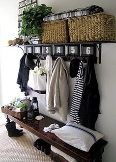 I love this idea for the front hall. DIY option for entry cabinet if all solutions are too colonial or too deep. Bench, Hooks, Shelf above, baskets