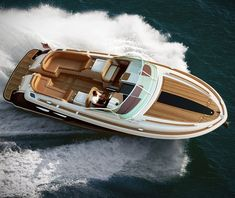The Corsair 36 yacht is the new stylish super boat by Chris-Craft Boats. The yacht features an open aft lounge offering maximum seating, and boasts an electric dining table that hides away virtually undetected in the teak sole. The expanded aft sun p Alexandre De Betak, Chris Craft Boats, Sport Boats, By Any Means Necessary, Wood Boats, Boat Stuff, Yacht Boat, Boat Design, Yacht Design