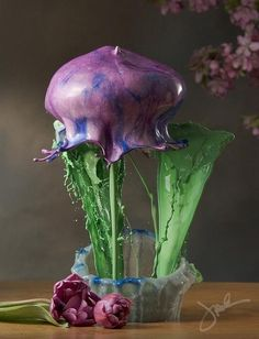 """Jack Long's sculptural looking Vessels and Blooms series. What at first looks like some form of blown glass or fluid 3D computer modeling, reveals itself as carefully planned and perfectly captured splashes of colored liquid."""
