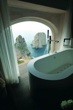 Hotel Punta Tragara in Capri, Italy, features awe inspiring views of the Faraglioni from the oversized bath of the Punta Tragara Art Suite. I know this is a hotel in Italy, but a girl can dream, right? And I do love that tub! Hotels And Resorts, Best Hotels, Luxury Hotels, Amazing Hotels, Hilton Hotels, Beach Resorts, Dream Vacations, Vacation Spots, Oh The Places You'll Go