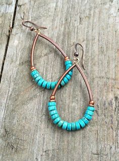 "Beautiful genuine turquoise heishi cut stones with antiqued copper hoops. Total hanging length approx 2"" and light weight."