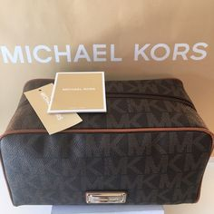 MICHAEL KORS NEW YRAVEL BAG 100% AUTHENTIC FINAL PRICE !!!!!!MICHAEL KORS LARGE NEW WITH TAGS NEVER USED BROWN TRAVEL COSMETIC BAG.  VERY LARGE BAG TO ACCOMMODATE ALL OF YOUR NEEDS.  BROWN PEBBLE LEATHER.  THE BAG MEASURES 10 INCHES WIDE BY 5.5. INCHES TALL AND 5. INCHES DEEP. Michael Kors Bags Travel Bags