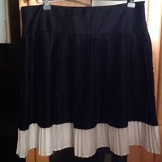 "Ralph Lauren Black & White Pleated Skirt Preowned Ralph Lauren Accordian Pleated Skirt. Black and white. This is a fountainhead style skirt. Knee level. Length of skirt is approx. 23"" and  waist is approx 41"" Ralph Lauren Skirts"