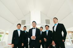 Cool groomsmen in suits and blue bowties | Jay and Amy's Destination Wedding at Tirtha Luhur, Bali