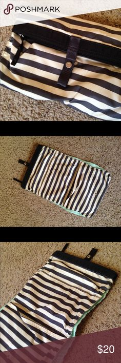 Lululemon Laundry/Toiletries Bag Striped fold out bag. Has zippered mesh pocket for sweaty clothes. Has pockets for ziplock bags or toiletries. Great condition, used once. lululemon athletica Bags Cosmetic Bags & Cases