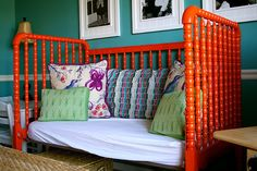 old crib to couch in playroom - orange spray paint