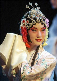 An actress shows costume and decorations used in Beijing opera performance during a Chinese opera costume show in Jinan, capital city of east China's Shandong Province, June 22, 2006.