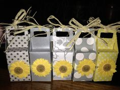 Wedding party favors: for sunflower/ yellow grey theme- Using a cricket machine, get strong card stock from Michaels, place candies inside as gifts for the guests (chocolate, dinner mints etc). Tie them up with raffia and wa-la! Decorative gifts that dress up the reception table!