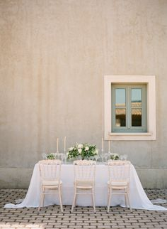 Photography : Vasia Photography Read More on SMP: http://www.stylemepretty.com/2016/07/25/white-on-white-greek-wedding-inspiration/