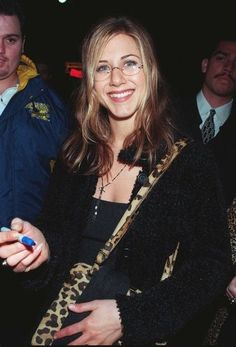 Jen wore round eyeglasses and a big grin at the Good Will Hunting afterparty in 1997.
