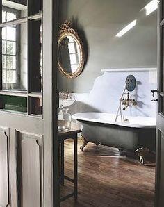 claw footed tub backsplash adds period character...greige...