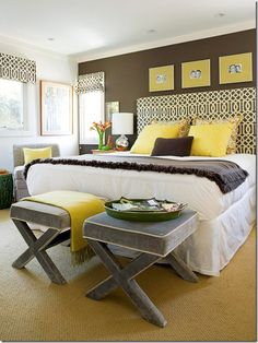 Brown and Yellow Bedroom...Love the fabrics, colors and stools at the end of the bed.