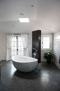 marble sink, white curtains, french doors, skylight