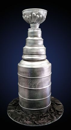 Repinned from a website...Stanley cup cake - I did quite enjoy working on this very tall cake, it measured around 40 inches in length and it had to be transported in 2 pieces, made out of chocolate cake and some styrofoam, the bottom largest rounds are 12 inches with the bowl at the top being around 8 inches.