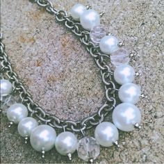 White Shell Pearl & Quartz Statement Necklace SS Fantastic necklace from an independent jewelry designer.   Sterling silver chain featuring shell pearls of varying sizes intermixed with faceted quartz dangles.   Absolutely stunning and fun, and goes with anything.  Great for work or dress up, but I LOVE the way it looks with just jeans and a tee- it pulls your whole outfit together!   Decorative hand painted turquoise wood bead dangles from clasp.  Note- clasp has some tarnishing.  Worn once…